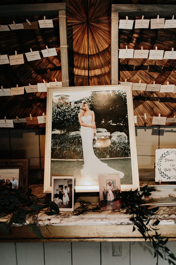 Rustic elegant wedding reception decor. Such a fabulous idea for displaying your bridal portraits at your wedding (Gloria Goode Photography)