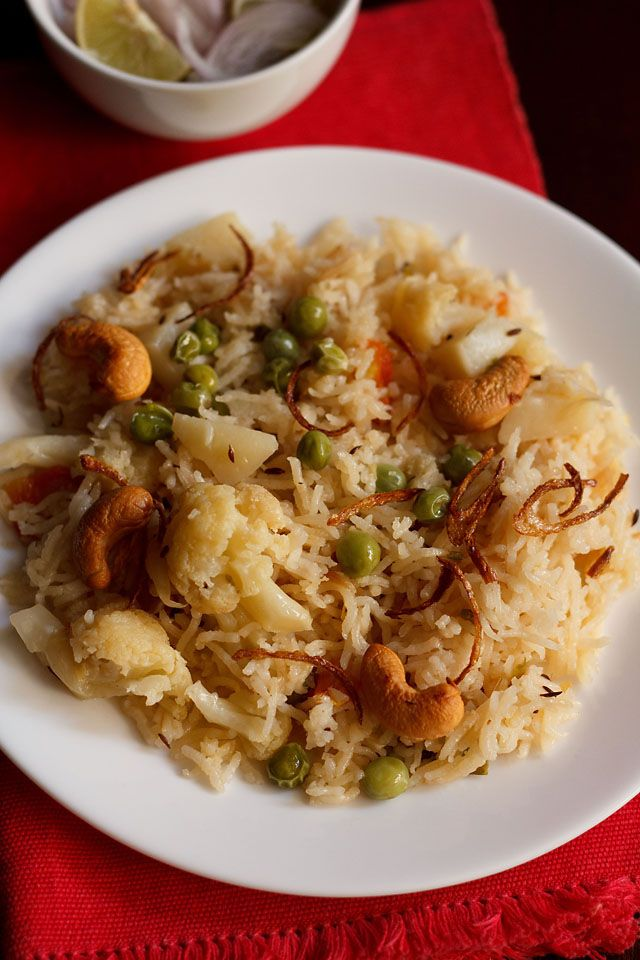 veg pulao recipe. easy and quick vegetable pulao recipe cooked in a pressure cooker. one pot comfort meal of vegetable pulao recipe made easy and quick.