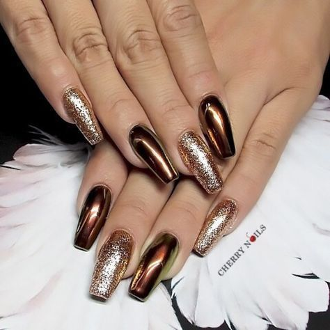 Bronze nails by Cherry Nails Spa. Mix and match chrome and glitter for a nail design that is next level.