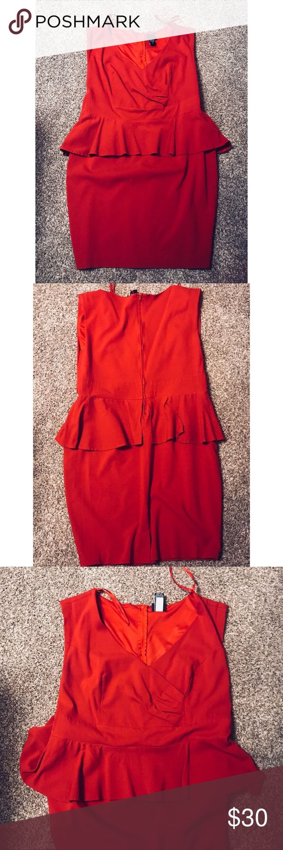 """Torrid 18 Gorgeous Hot Red Peplum Sleeveless Dress This gorgeous peplum dress is a size 18 and in excellent condition! Ponte fabric has a little stretch to it! Zipper closure in the back and a beautiful pencil skirt on the bottom. Faux wrap waist detail and darts at the bust. V neck. Add your favorite skinny belt if you like! Tag says """"cut date 8/12."""" torrid Dresses Midi"""
