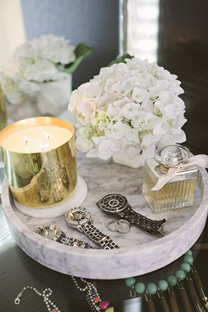 round marble trays adorne this end table spicing up the look and feel of the space