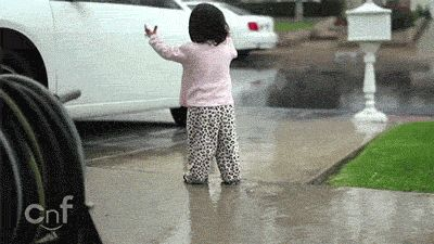 This little girl for reminding us to enjoy the rainy days.