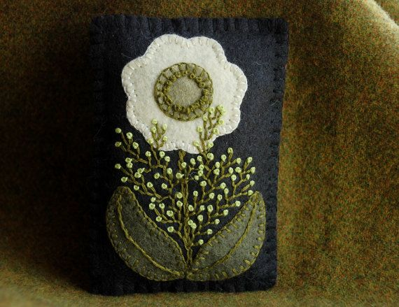 Filled with about two ounces of Maine balsam, this wonderfully scented little sachet is topped with a unique, original wool applique design.