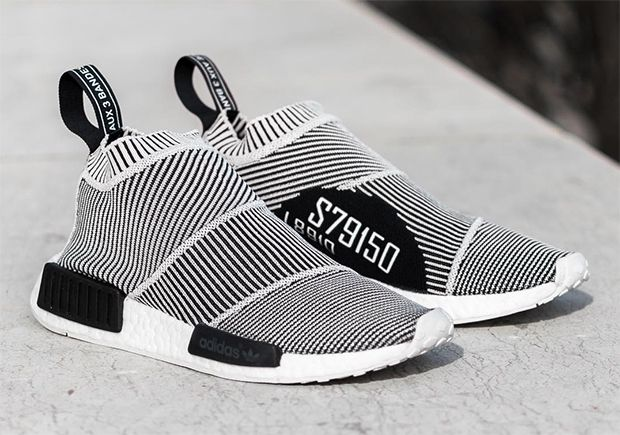 adidas Originals continues to create crazy silhouettes utilizing the patented combination of Primeknit and Boost, and their latest creation, the adidas NMD City Sock, is something straight out of Beetlejuice's closet. The white and black piping throughout the mid-top silhouette … Continue reading →