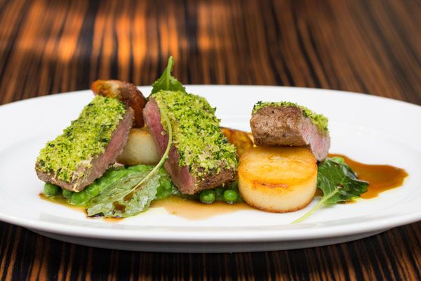 ... lamb saddle with sweet pea purée, sarladaise potatoes and mint sauce