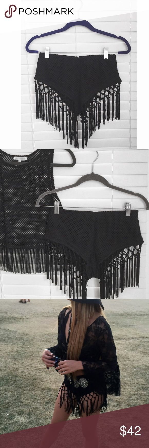 BLACK FESTIVAL SHORTS Bought from Lex Mila, worn once to coachella, amazing condition!!!! Adorable for festivals !!! Not sold online anymore. A bit high waisted, and has fringe  size s/m NG for exposure Nasty Gal Shorts