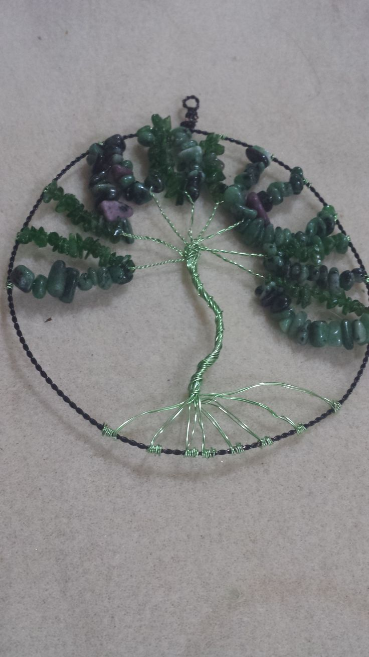 Hand crafted Tree of Life. Black twisted Wire frame with Chartrouse wire wrapping detail, Chrome Diopside chips and Ruby Zoisite small nuggets