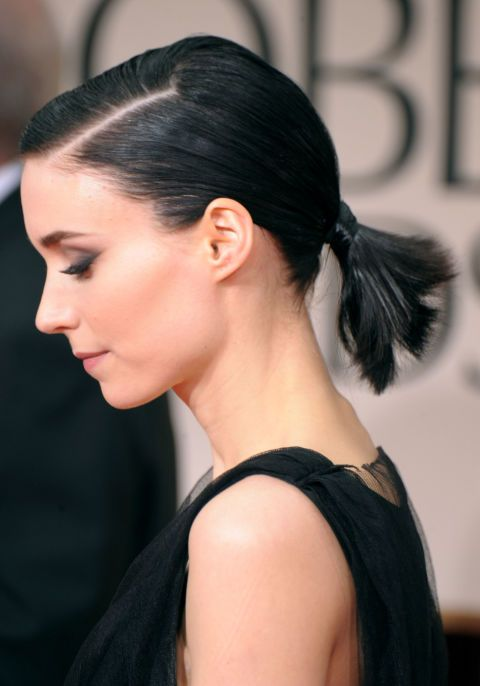Ditch the extensions and go for a short mini ponytail for a chic and simple look as seen on actress Rooney Mara.