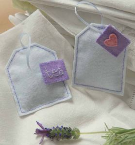 They are made with felt and filled with lavender, so she can tuck them somewhere and make everything smell great!