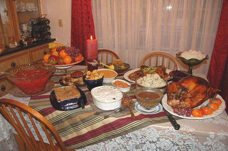 A (not so) traditional Thanksgiving dinner: Tender, juicy roast turkey with old-fashioned gravy, cranberry sauce, smashed potatoes, baked green beans, sweet and sour cod, steamed rice, achara (pickled green papaya relish), leche flan, pig in a blanket, and apple crisp.