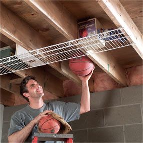 Screw wire closet shelving to joists in your garage or basement. Wire shelving is see-through. *Recycle project also!