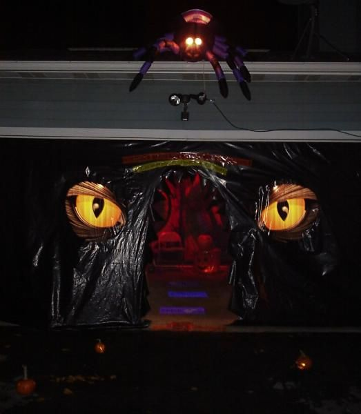 Google Image Result for http://www.halloweenforum.com/members/harmonicaman-albums-haunted-garage-2009-picture48849-wife-does-nice-yard-display-lines-driveway-luminaria-then-youre-faced-entrance-haunted-garage-enter-if-you-dare.jpg