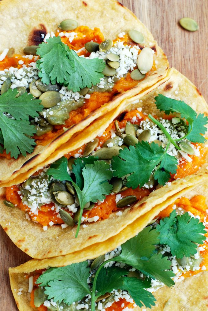 These Sweet Potato Tacos couldn't be easier or more delicious! BOOM. That's the sound of the flavor/texture explosion that is sweet potato tacos. If you haven't tried sweet potatoes and avocados together you haven't really lived. Also? These tacos are a texture lover's dream. The tortillas get a nice bite to them, the sweet potatoes and avocados are creamy while the pepitas add a bit of crunch. If you didn't know that comfort food could also be healthy, welcome to taco town. A little...