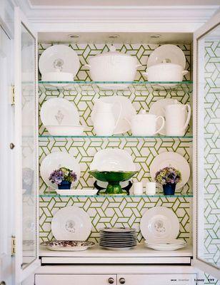 Wallpaper inside cabinets.