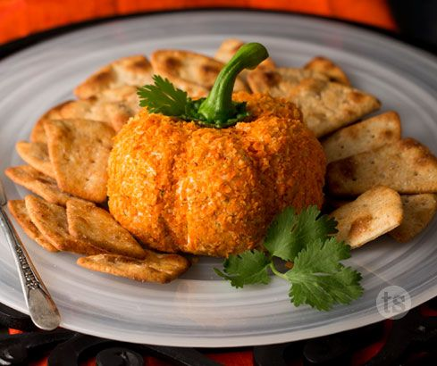 This adorable Gorgonzola and Olive Cheese Ball Pumpkin is the perfect appetizer addition to your Halloween or Thanksgiving spread.