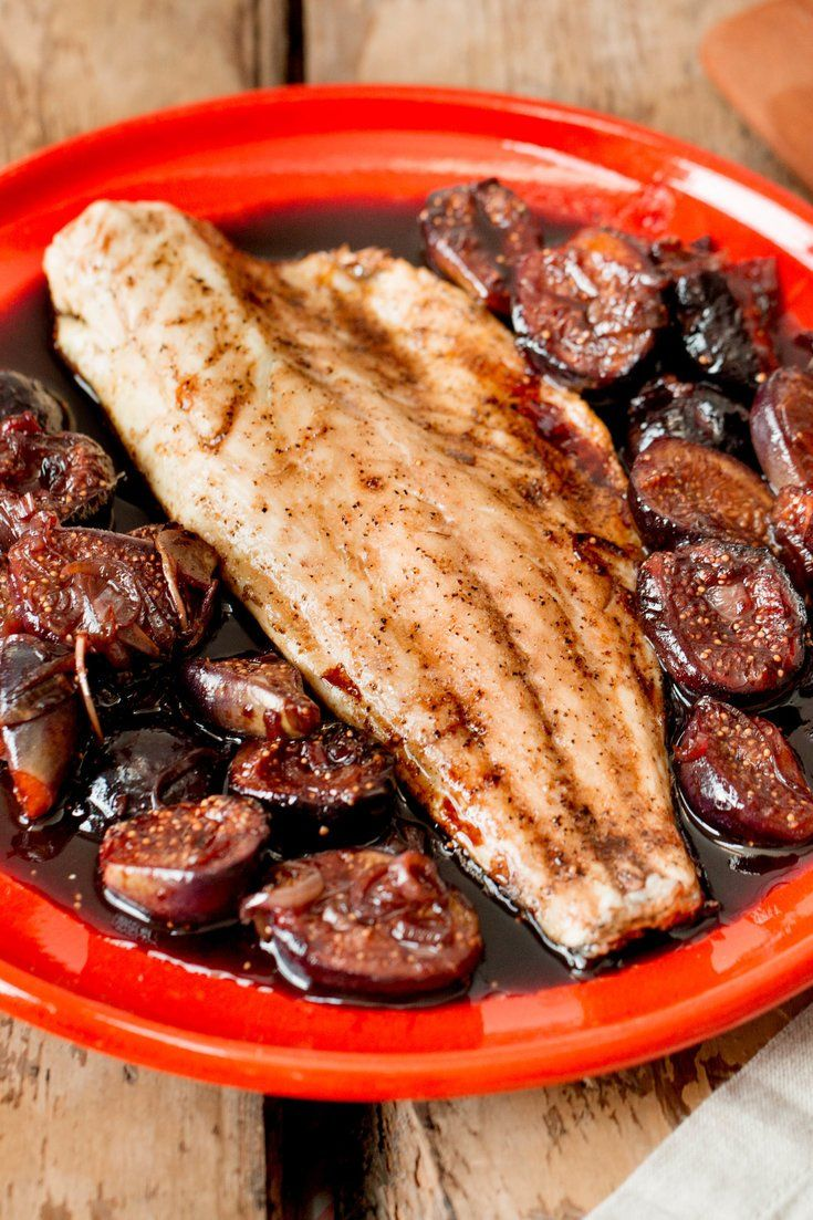NYT Cooking: This recipe is inspired by a dish served at a pinot noir dinner at Bar Boulud, one of the chef Daniel Boulud's restaurants. There, a whole wild striped bass was swaddled in fresh fig leaves and stuffed with fresh black figs in a red wine sauce. The brooding sauce bathed velvet figs, and its earthy depths made the already succulent fish a fine partner for some exc...