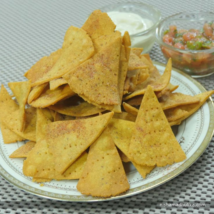 These crunchy and crispy Nacho chips will add more charm to your gatherings. Recipe in English- http://indiangoodfood.com/2526-nacho-chips.html (copy and paste link into browser)  Recipe in Hindi- http://nishamadhulika.com/1642-nacho-chips.html (copy and paste link into browser)
