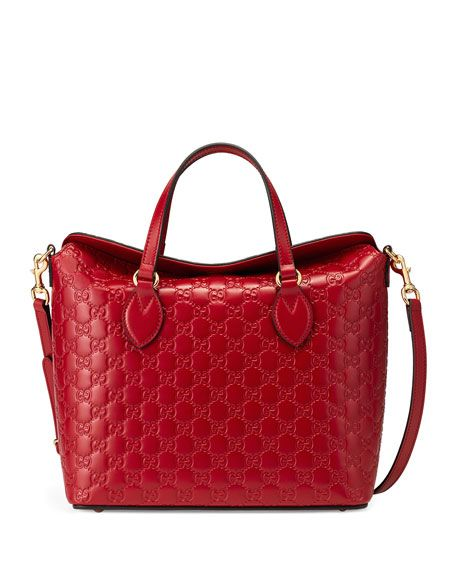 """Gucci Guccissima leather tote bag with golden hardware. Flat top handles, 5""""…"""