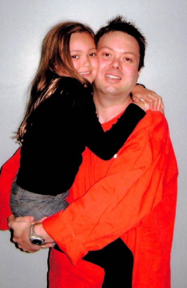 Jail visit: Killer Carl Williams and his 'princess', daughter, Dhakota. Picture…