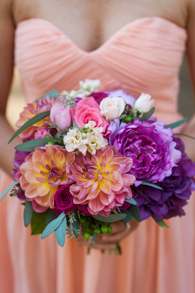 Donna Morgan Peach Fuzz bridesmaid dress with pink and purple wedding flowers // Colorful bridesmaid bouquet