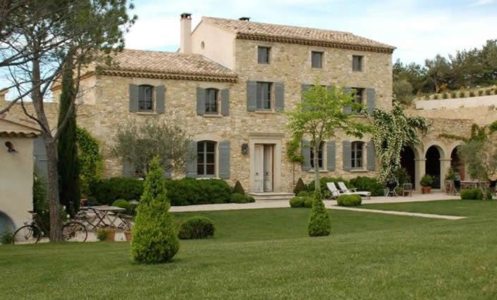 Provence. Stone. Pale shutters. Irregular roof and wings. Breeze-way.