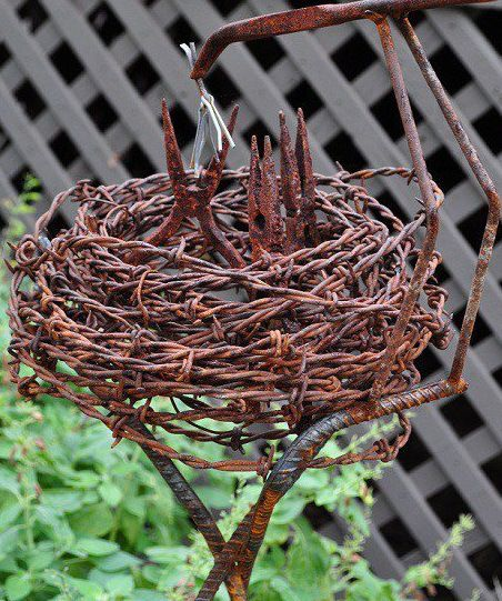2 – Rusty Little Birds  This incredible piece of garden art made by Bob Pool is one of the best uses of otherwise useless rusty garden tools...