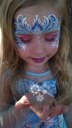 Elsa frozen Face paint by Melinda Thompson   www.facebook.com/tucsonfacepainter.  One stroke painting. Girl face paint. One-stroke frozen crown. Snow flake facepaint. Elsa glitter mask.