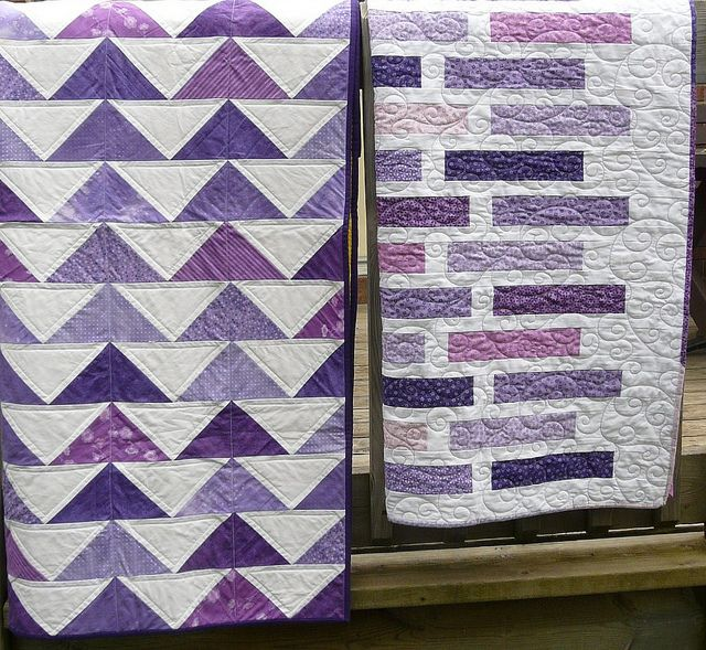right - Flock of Triangles from Denyse Schmidt Quilts, quilt on left is Doodle Bricks