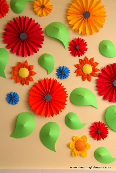 Flower Wall and Paper Pinwheel Tutorial / attach pinwheels to windows to give some color and privacy