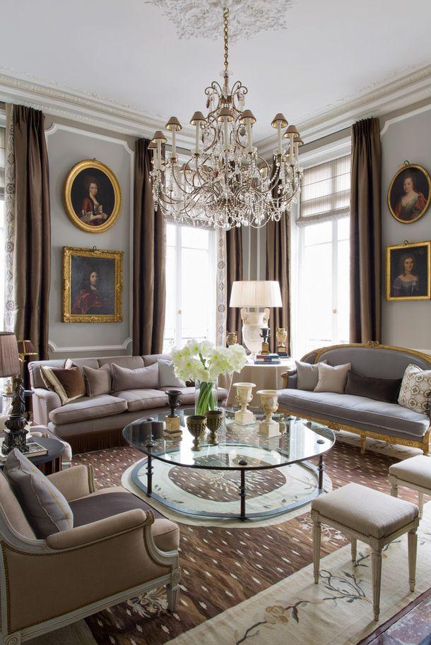 Large rug - fits entire seating area & w/the glass/floating coffee table it still seems light & airy Apartment in the style of Louis XVI at Paris from decorator Jean-Louis Denio