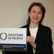 Anne-Parkinson-of Mayes with-Investors-in-People-plaque-