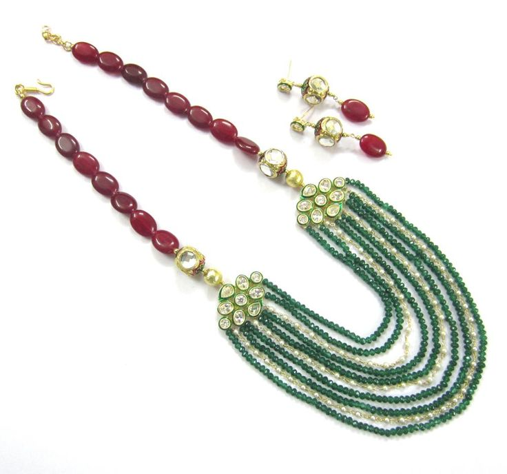Semi precious jade Plain ovals, High quality Kundan connectors, Jadau balls,pearls chains and glass roundels  Dimensions : 26 inches approx including pendant and hangings,2 inch adjustable chain & hook  Material Used : Semi precious jade Plain ovals, High quality Kundan connectors, Jadau balls,pearls chains and glass roundels  Other Details : Color - Deep Red, Green , Ivory white , Golden  For more details : http://www.indiebazaar.com/product/70136/kundan-necklace-set?ref=prod_ms