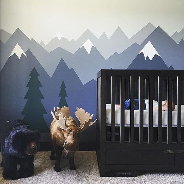 This tiny one is hibernating in his crib for the first time! Love this He Will Move Mountains-inspired nursery.  via @jenbelbs