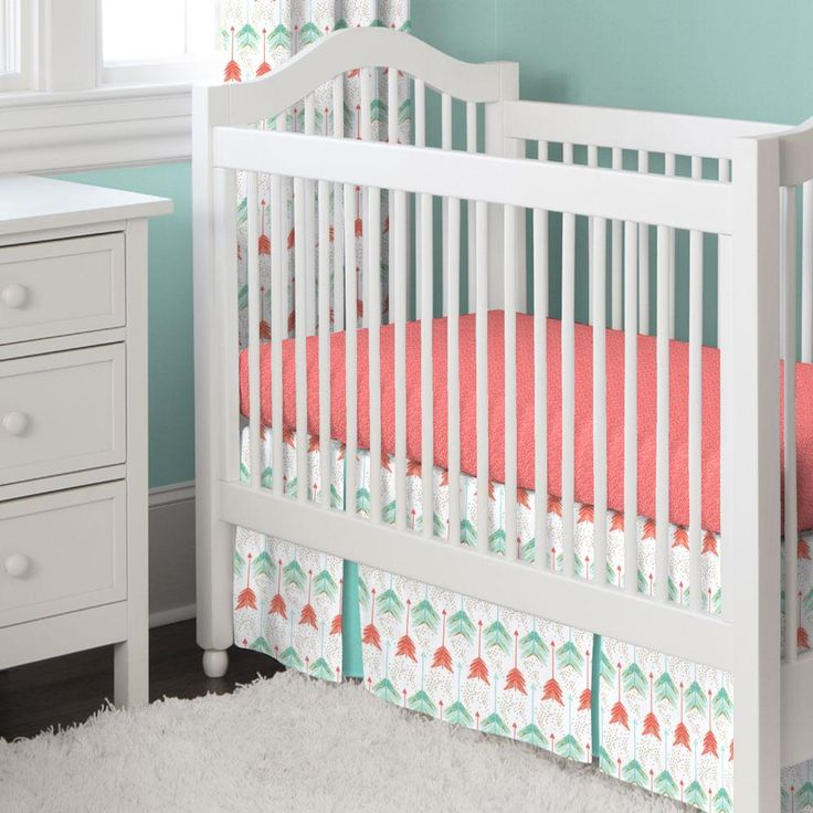Crib Dust Ruffle in Coral and Teal Arrow by Carousel Designs.