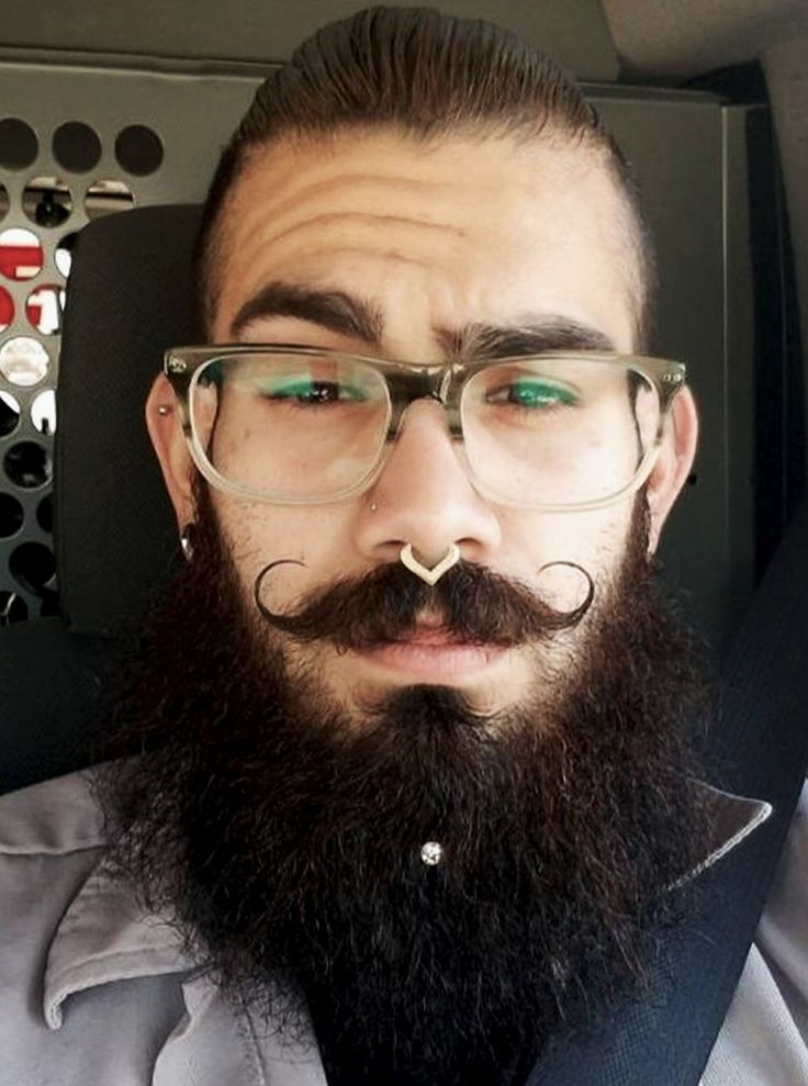 Handlebar moustache is trending again! Curved moustache hair ends in a spiral toward the cheekbones, creating a great beard style. Adding a beard crystal piercing is a modern take on classic style.