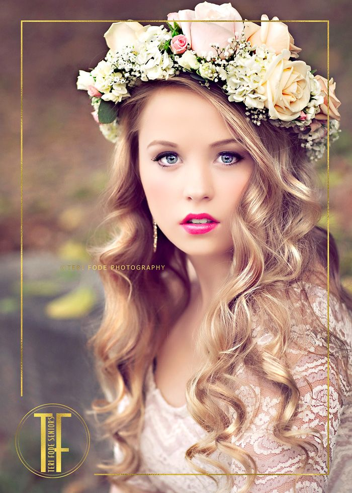 A vintage styled photography session with a floral wreath and BOLD lips.