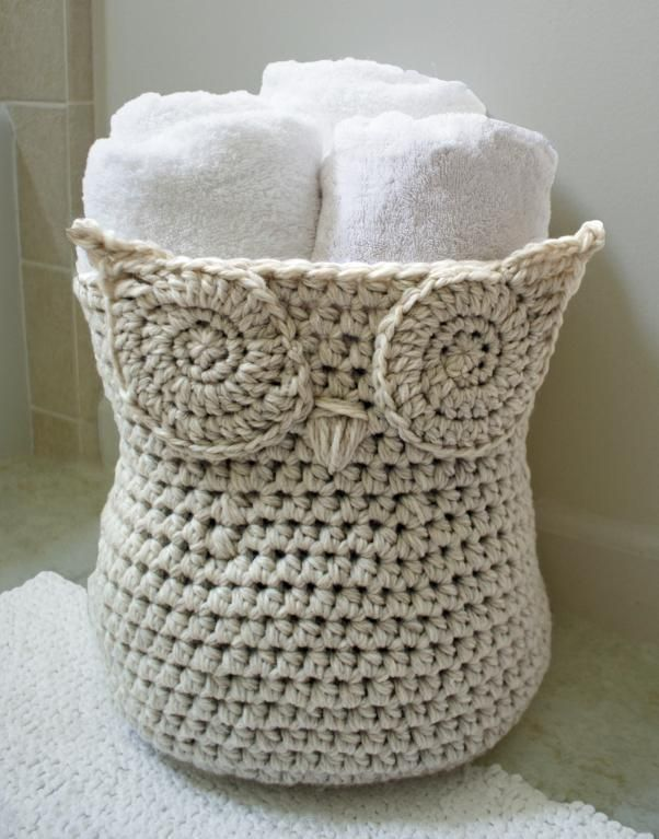 """""""This monochromatic owl basket by Deja Jetmir is simple & chic with a twist. Its generous size (28 ins around x 12 ins high) can hold three full size rolled up towels. But don't stop there! Use it to hold toys in the kid's room, or odds & ends in the living room. Using thick yarn it is sturdy and can stand up on it's own, yet can collapse flat when not needed"""". Crochet pattern $2.99"""