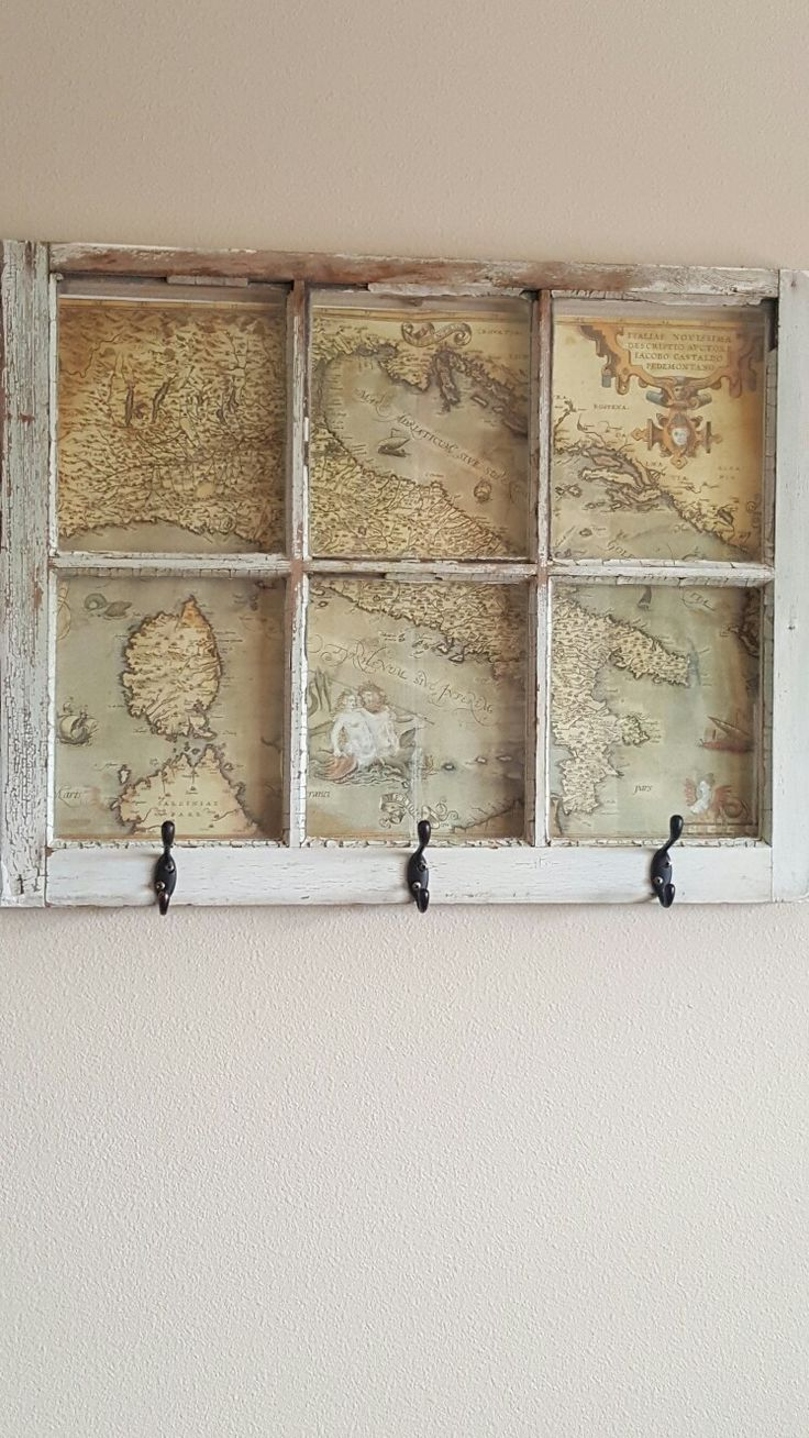 DIY coat rack! Use an old window and add in your favorite travel memories!
