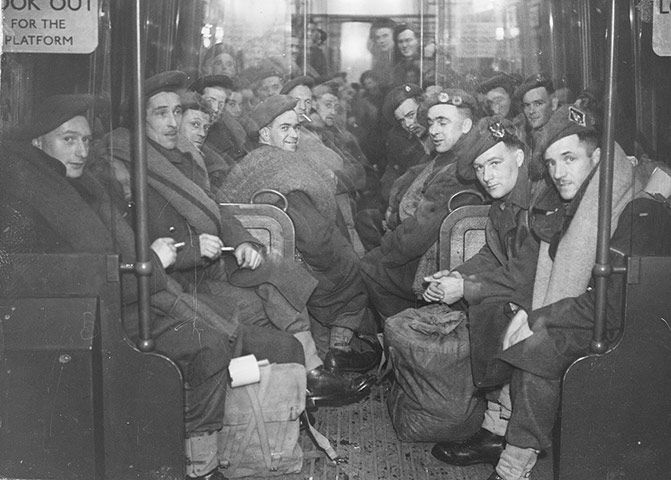 Soldiers returning home on the London Underground after the end of the second world war, 1945