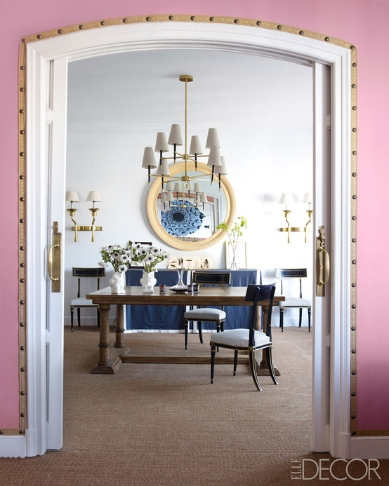 Love the pink!  Nail head and trim detail contrast against the pink walls.