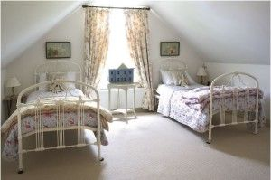two white iron beds