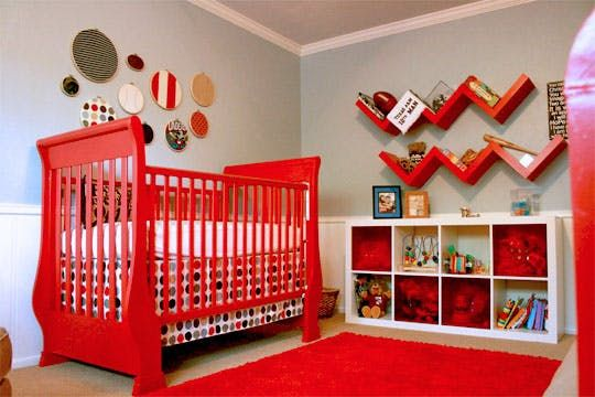 """Name: Tripp (6 weeks)Hometown: Dallas, TXRoom size: 19"""" x 13"""" Red is the color of love, vitality, fire trucks, and cherry sours, so what a perfect accent color for a nursery. Tripp's mom, Jennifer, went all out with the red pops to create a bright, happy place for her new baby boy. We love the fire engine red crib and daybed, the vintage plumbing valve dresser knobs, and the bold, graphic alphabet wall. Jennifer did a wonderful job designing this room, and it's a good thing ..."""