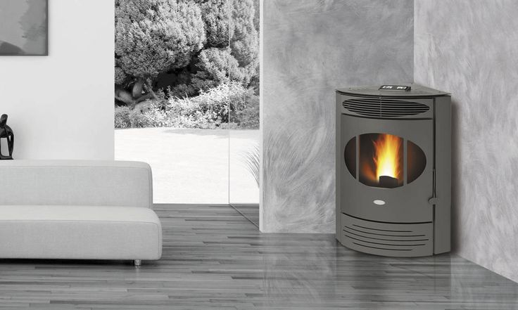 Pellet heating stove / contemporary / steel / corner X12 FAIR srl