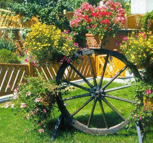Unusual Garden Ideas: 25+ Beautiful Wagon Wheel Garden Ideas On Pinterest