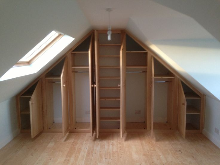 A bedroom is made in this newly converted loft. Bespoke solid oak wardrobes  to maximise