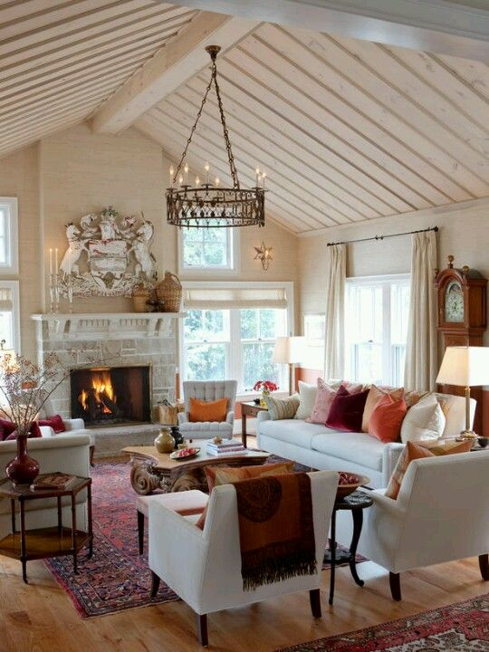 Simple furniture. Ornate accents. Color heavy on the bottom of the room, balanced by texture neutral on the ceiling and the iron light. Sarah Richardson Farmhouse living room