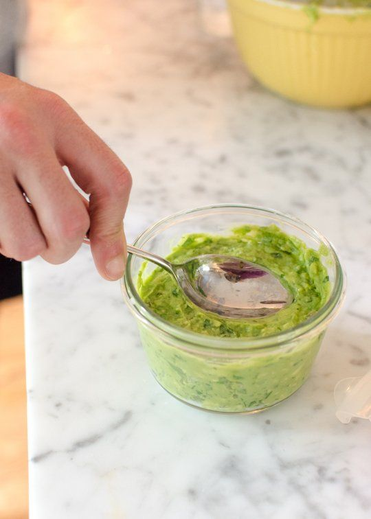 Genius! Keep your guacamole green with just a little water on top before it goes in the fridge. It keeps out oxygen, so when you're ready to eat it, pour off the water and give it a stir. The consistency and taste haven't changed!