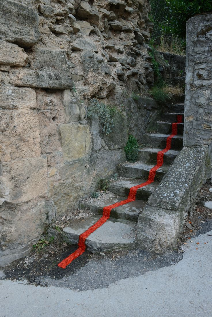 A rivulet of red pouring down ancient steps in Cañete, Spain, is made from poppy petals Goldsworthy collected from fields and then fixed to the steps with water.