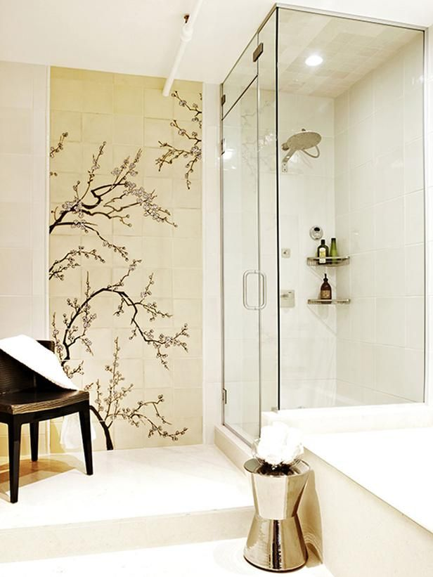 This bathroom includes a steam shower, large tub and double-sink vanity. The custom cherry blossom tile mosaic gives the bathroom a unique a...