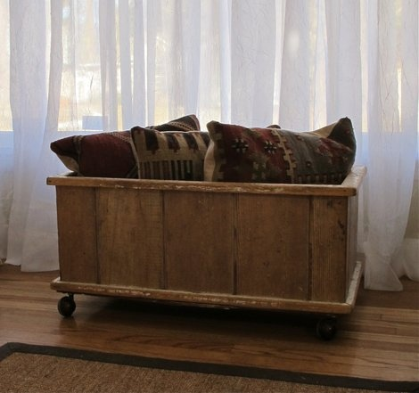 This vintage wood box has many uses around the house.